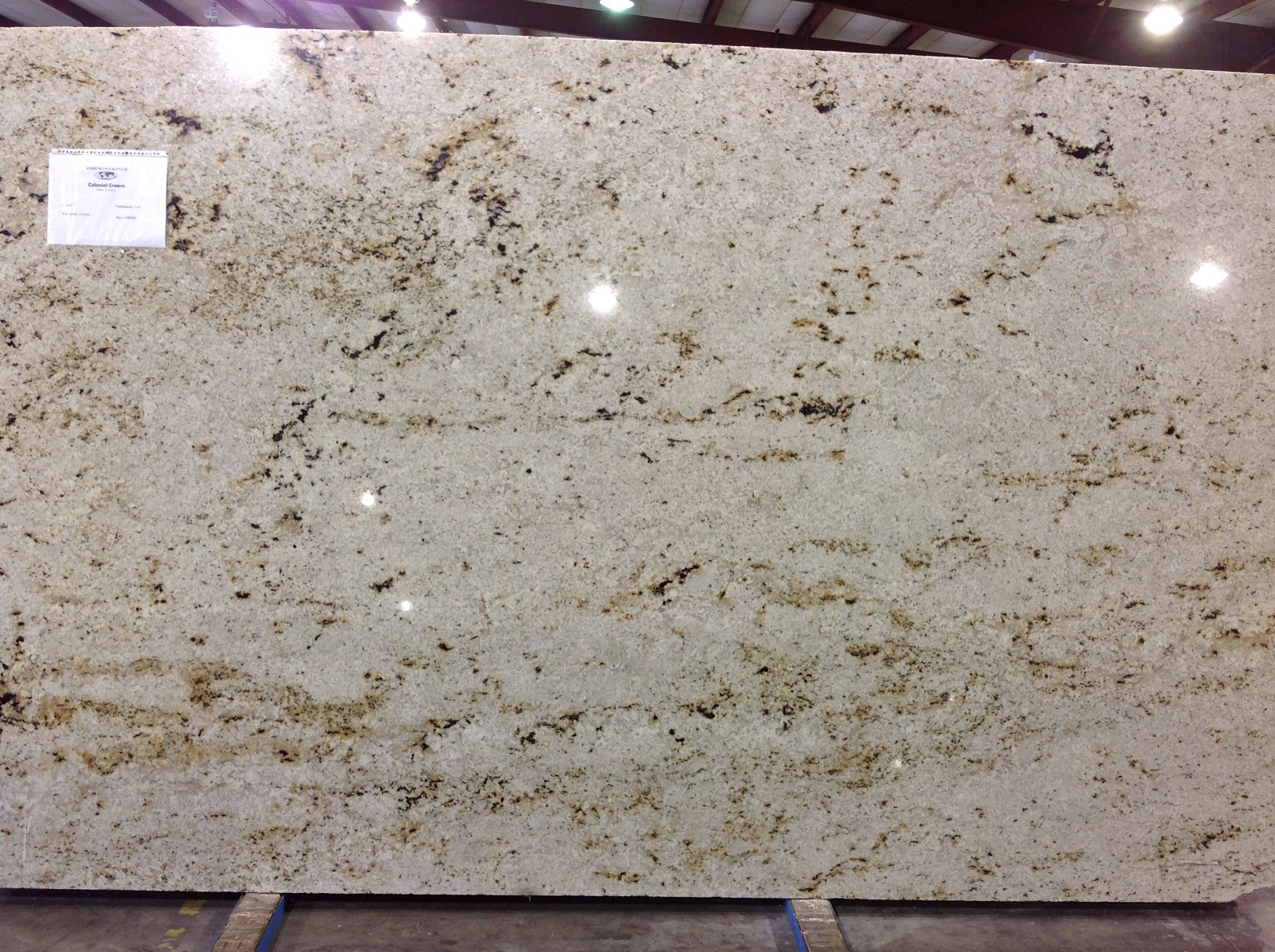 colonial cream omicron granite tile